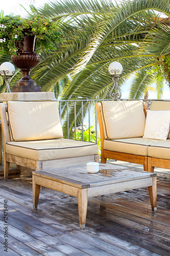 terrasse mit palme stock photo and royalty free images. Black Bedroom Furniture Sets. Home Design Ideas
