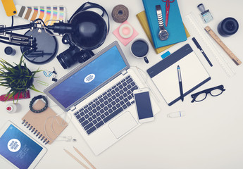 Responsive Mockup of Devices on a Messy Desk 2