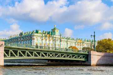 Winter Palace on the embankment of Neva river and Palace bridge in Saint Petersburg,Russia