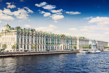 View of Hermitage palace and Neva river under blue sky, Saint Petersburg, Russia. Famous scenic place.