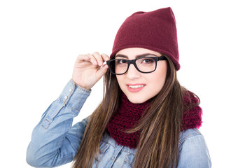 portrait of young woman in winter clothes and glasses isolated o