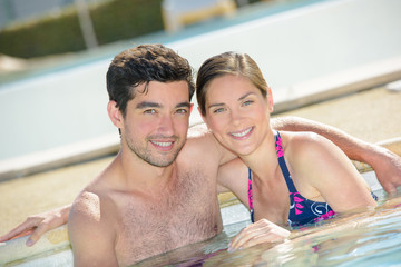 Portrait of couple in a pool