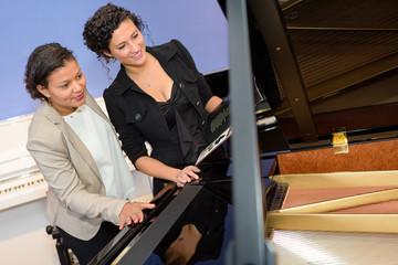 women in the piano shop