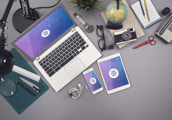 Laptop, Smartphone, and Tablet on Cluttered Gray Desk