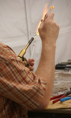 Glass blower doing delicate work