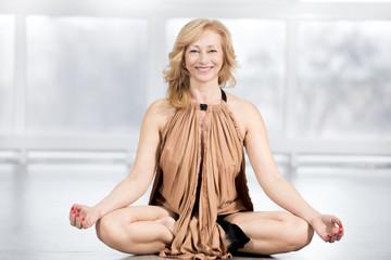 Senior woman sitting in yoga posture