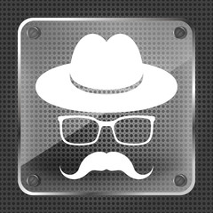 Glass hat with mustache and glasses  on a metallic background