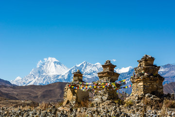 Buddhist chorten above Muktinath village, Dhaulagiri rising in the babkground.