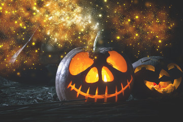 Halloween pumpkins at wood background.