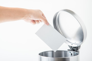 throwing away card for writing message in trashcan