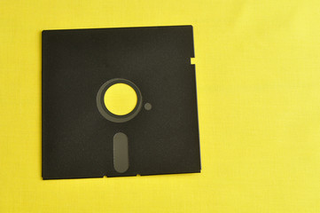A single floppy disc isolated on yellow background