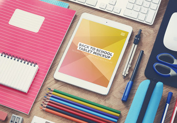 Tablet and School Supplies on Desk Mockup