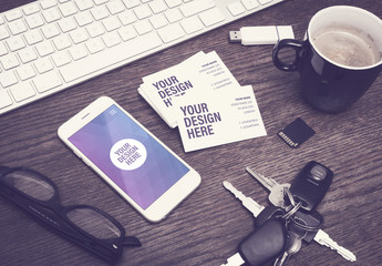 Smartphone and Business Cards on Wooden Table Mockup 1