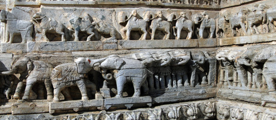 Elephant sculptures support the base in Hindu temple in Udaipur in Rajasthan, India, Asia