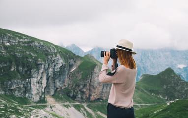 Traveler or hiker in the mountains in the National Park Triglav, Mangart, Slovenia