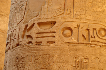 Ancient Egypt. The wall are decorated with carved hieroglyphs. Karnak Temple. Luxor. Thebes.