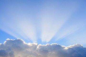Cloudy sky with the beam of sunlight shinning.