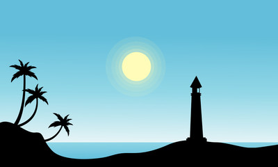 Silhouette of lighthouse on beach