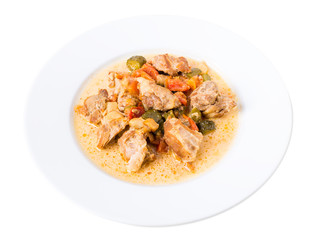 Baked pork meat with vegetables.