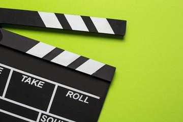 movie clapper on green background