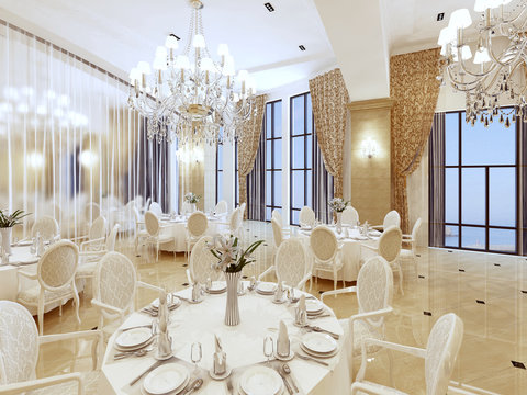 Luxurious ballroom, with white tables and large Windows.