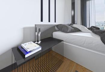 Designer bedside table with decor in a modern bedroom.