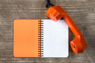 Telephone receiver and blank notebook