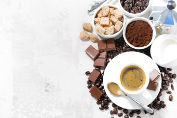 cup of espresso, ingredients and sweets and white background