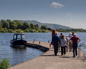 Kinross, Perthshire, Scotland, UK. May 31st 2016. Visitors to Loch Leven boarding snall boat to visit Loch Leven castle, Kinross, Perthshire, Scotland, UK