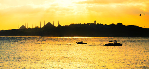 Istanbul skyline from across Bosphorus River in late afternoon