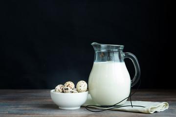 Concept of natural healthy organic food, Jug of milk and quail e