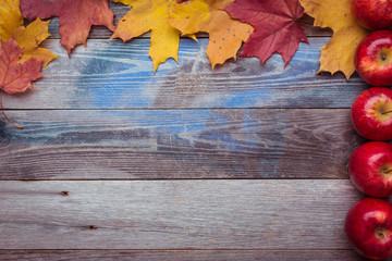 Frame. Fallen maple leaves on a dark wooden table