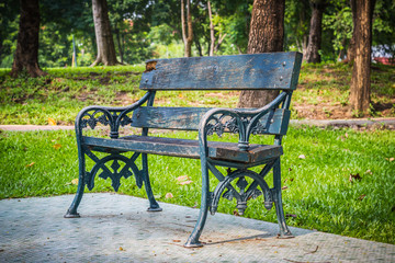 Empty Bench in the park for relaxing aisle.