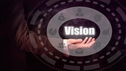 Businessman holding a Vision concept.