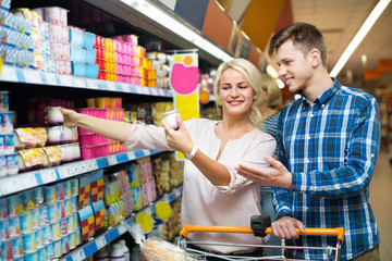 Ordinary family choosing dairy products