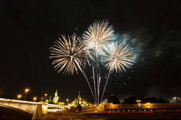 Fireworks over the Moscow Kremlin at night. View of the Moscow River, Russia