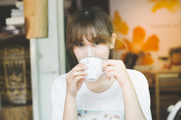 Woman drinking coffee for relaxed.