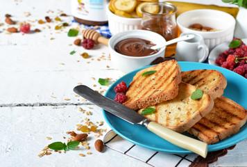 Good morning - toast with walnut, chocolate paste, banana and honey. White food background.