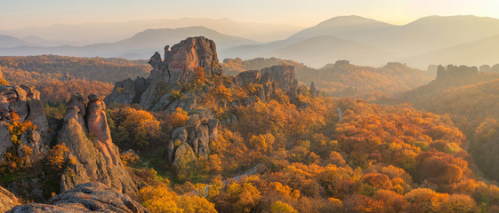 Belogradchik rocks at sunset / Magnificent panoramic sunset view of the Belogradchik rocks in Bulgaria, lit by the last rays of autumn sun