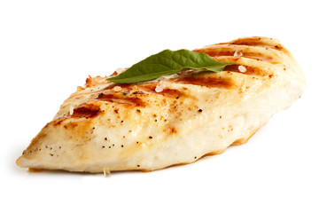 Whole grilled chicken breast with black pepper, rock salt and bay leaf.