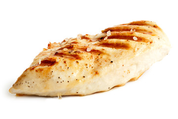 Whole grilled chicken breast with black pepper and rock salt.