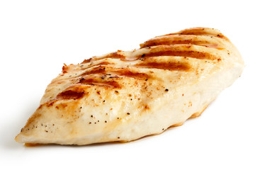 Whole grilled chicken breast with black pepper isolated on white.