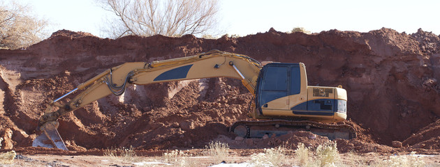 A Trackhoe Digging In The Dirt