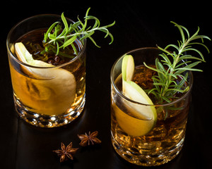Apple Old Fashioned garnished with rosemary