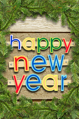 Nailed greeting text Happy New Year on wooden background with a frame made of spruce