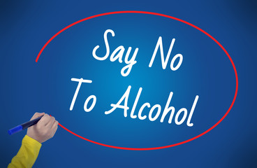 Women Hand writing say no to alkohol on blue background. Busines