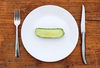 Half cucumber on plate..crash diet concept.