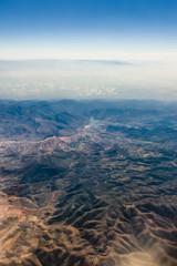 Obraz Widok z samolotu na horyzont i górskie szczyty - Atlas, Afryka - fototapety do salonu