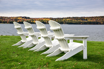 Lawn chairs in a row on the beach in Autumn
