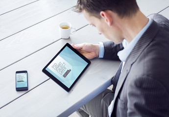 User with Tablet and Smartphone at Blue Wooden Table Mockup
